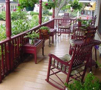 Front porch with railings and furniture